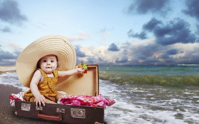 Little traveler in suitcase